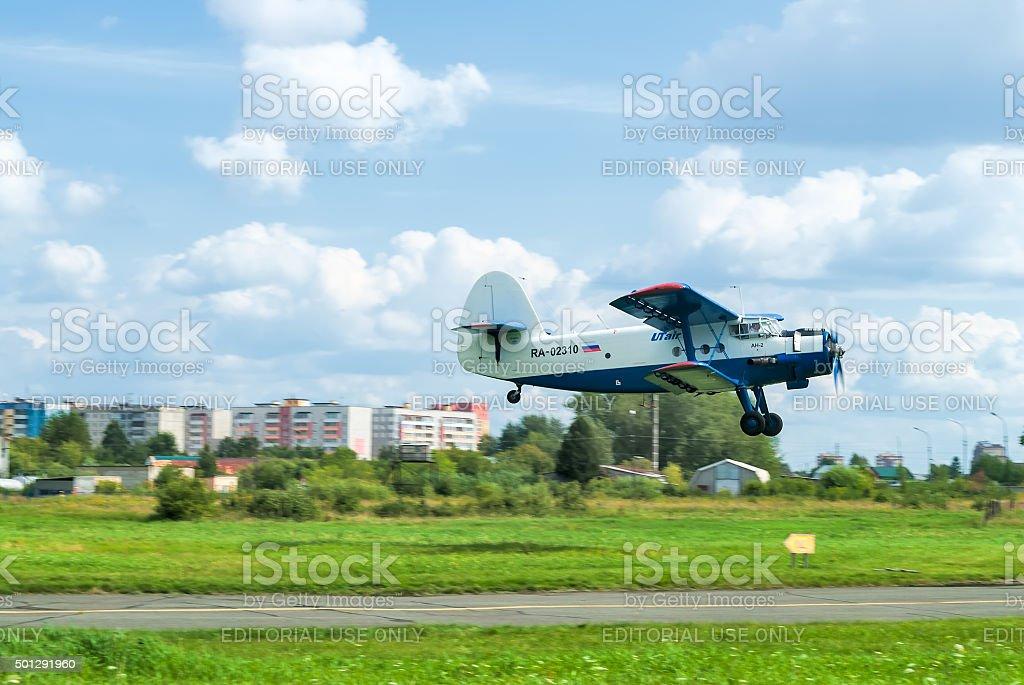 antonov an 2 airplane flies up, lands stock photo