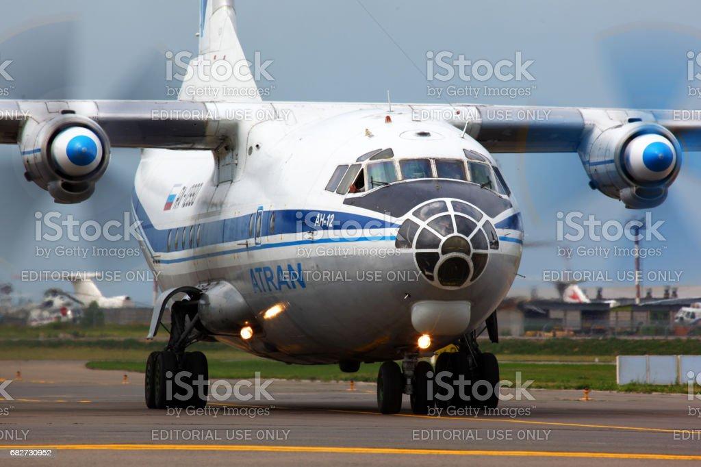 Antonov An-12 RA-12990 from Atran airlines at Vnukovo international airport. stock photo