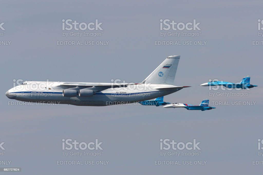 Antonov An-124 Ruslan and pair of Sukhoi Su-27 of Russian Air Force during Victory Day parade. stock photo