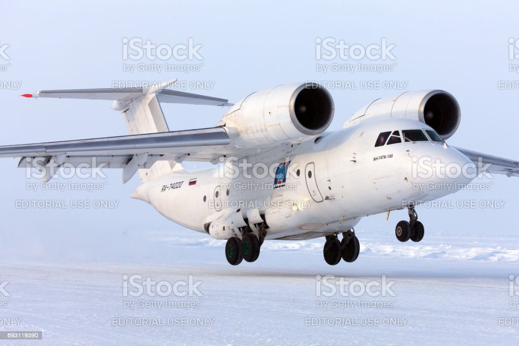 Antonov An-74 RA-74020 takes off at Barneo ice camp. stock photo