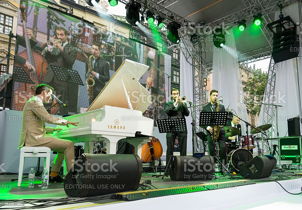 Antony Strong playing piano on stage jazz festival stock photo