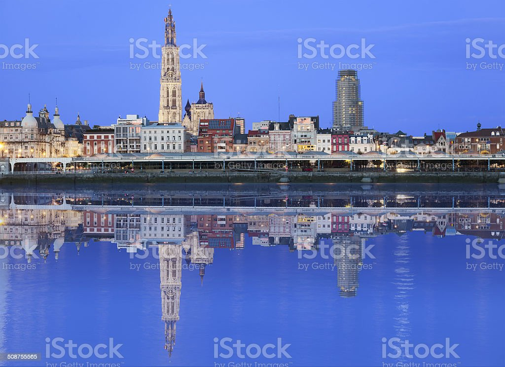Antwerpen skyline reflecting in river stock photo