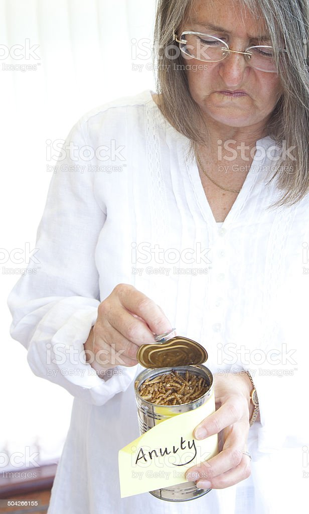anuity - woman opening can of worms stock photo