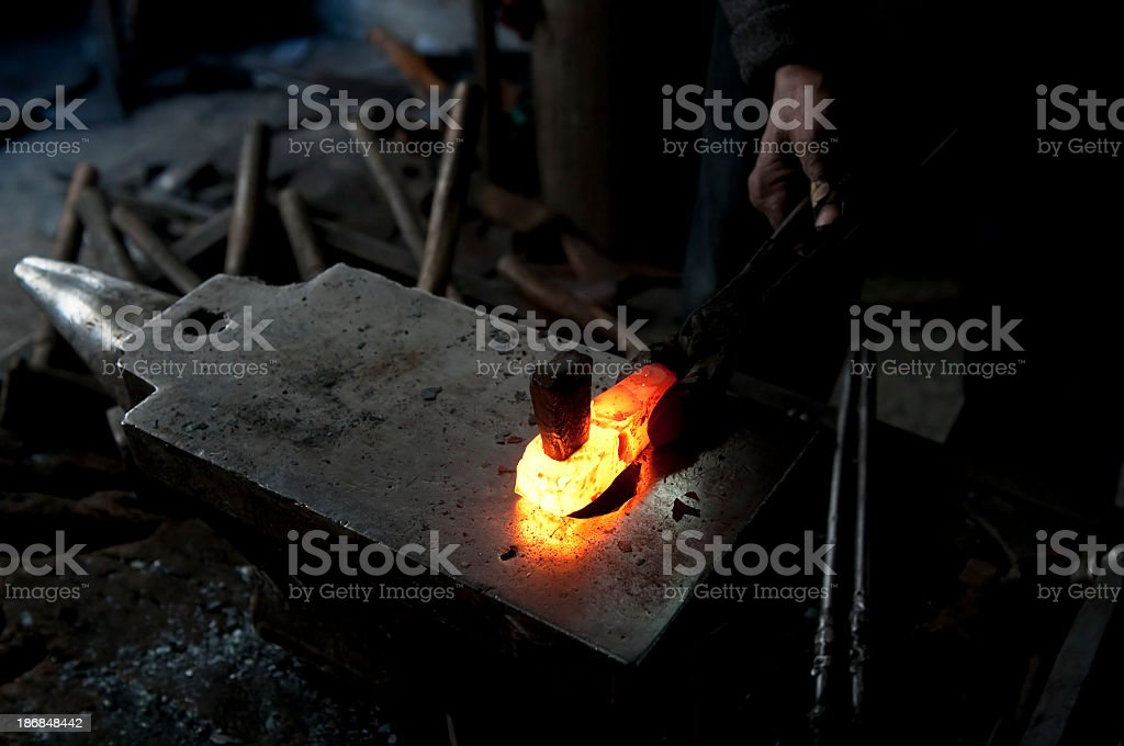 Anvil and Melting Steel stock photo