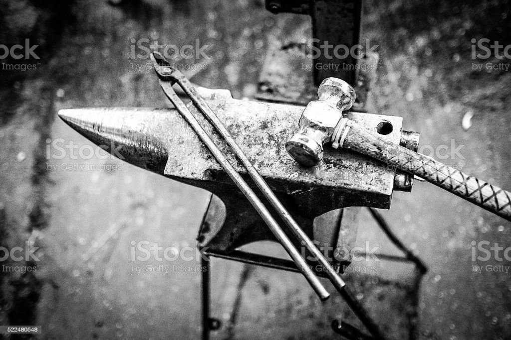 Anvil and tools stock photo