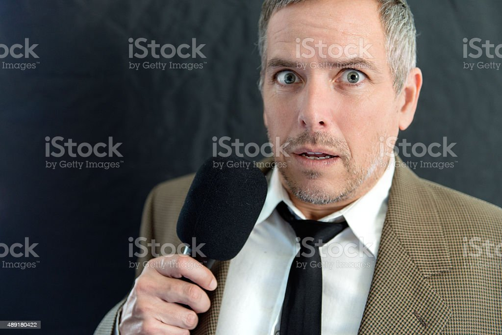 Anxious Man Speaks Into Microphone stock photo