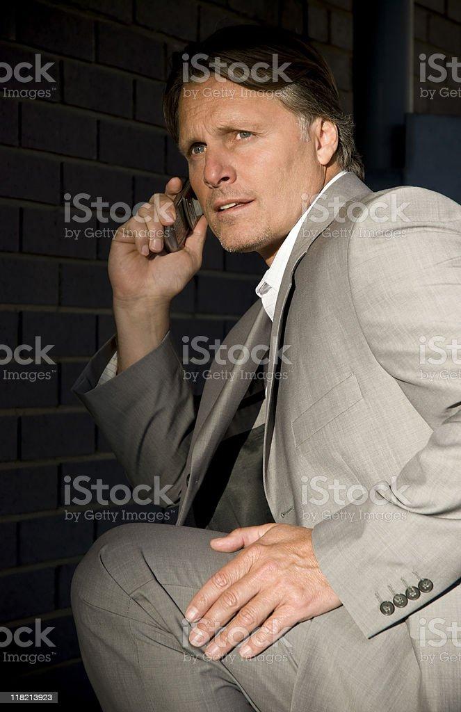 Anxious paranoid businessman. stock photo