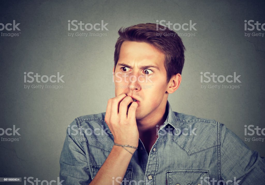 Anxious stressed young man looking away stock photo