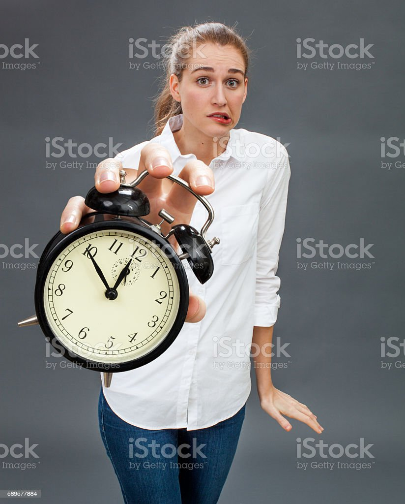 anxious woman for emphasis on stressful time and deadline management stock photo