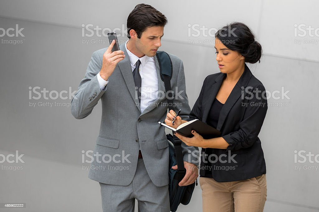 Anxious Young Fashionable Businessman and Businesswoman Solving A Work Problem stock photo