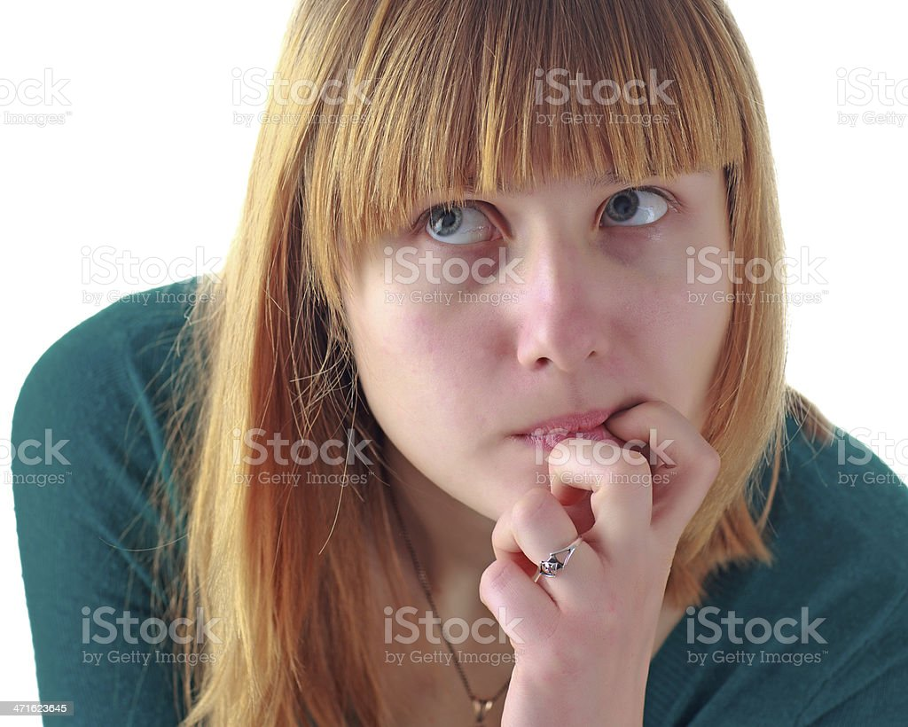 Anxious Young Woman Bites Fingernail And Looks Away royalty-free stock photo