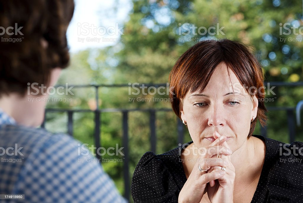 Anxious  Young Woman In a Counselling Session royalty-free stock photo