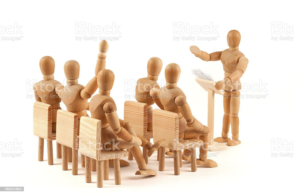 any questions - yes? meeting of wooden mannequins royalty-free stock photo