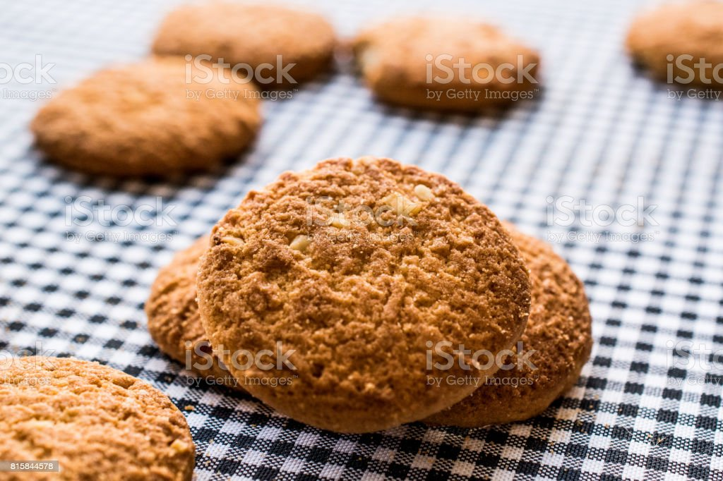 Anzac Biscuits on tablecloth. stock photo