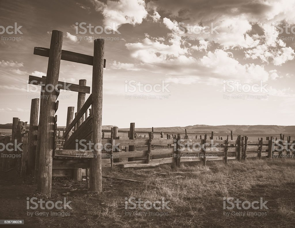 Apache Cattle ranch old west sepia wood pen cloud background stock photo