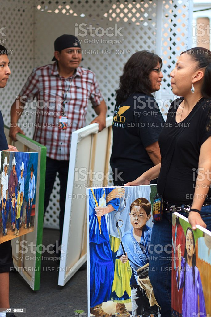 Apache Painter with Family and Paintings, Santa Fe Indian Market stock photo