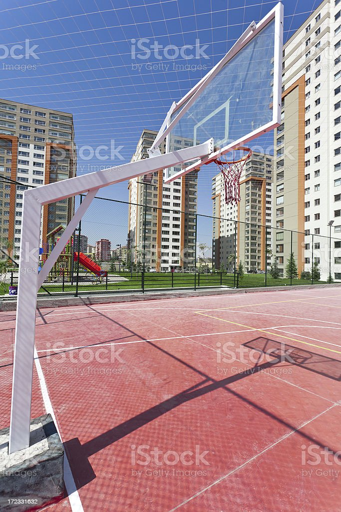 Apartment Block and basketball court royalty-free stock photo