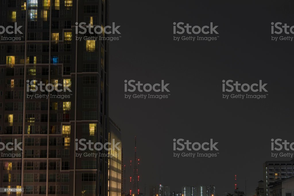 Apartment building at night stock photo