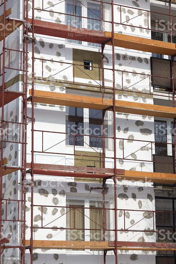 Apartment building being insulated royalty-free stock photo