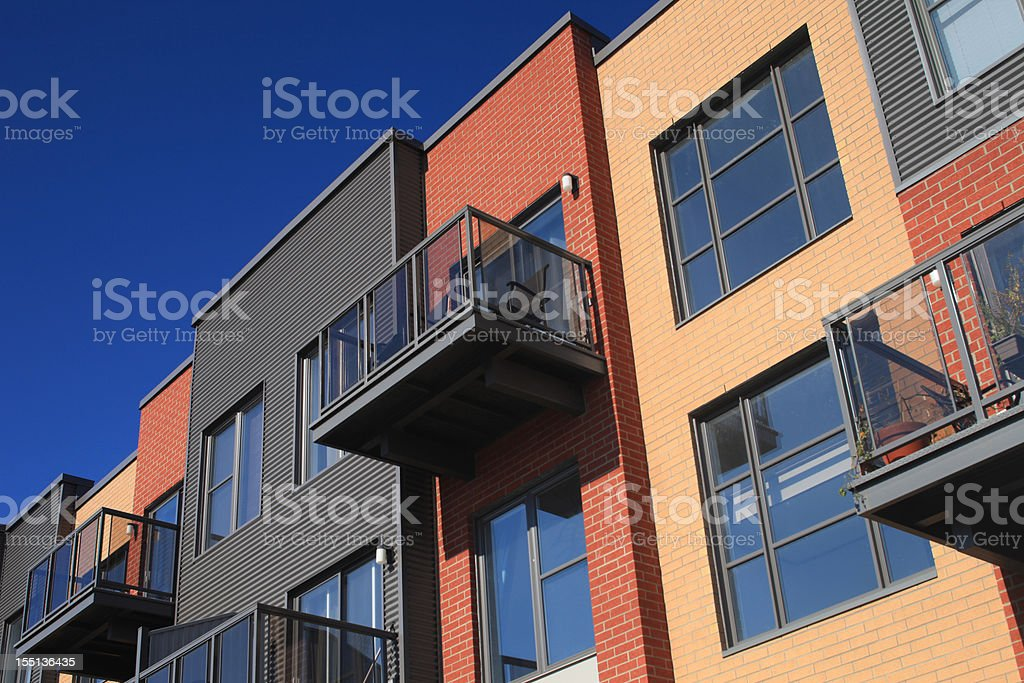 Apartment building close-up on windows balconies stock photo