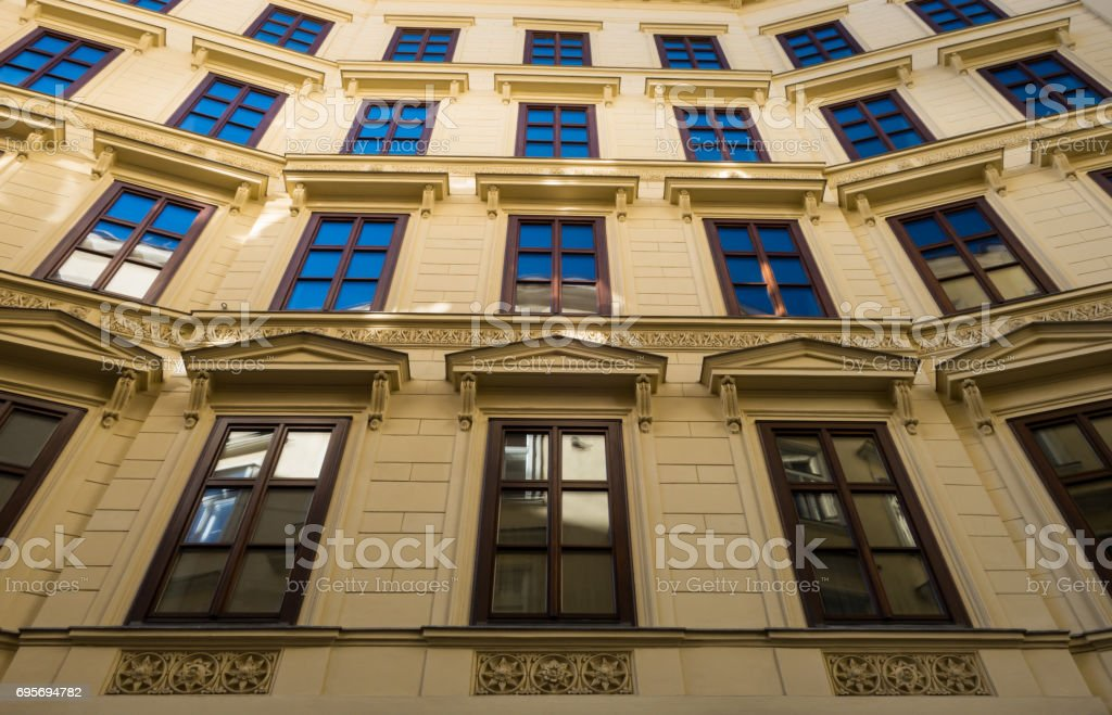 Apartment building front facade in Old Town Vienna stock photo