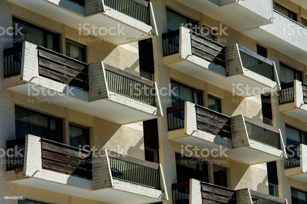 Apartment building front facade with balconies stock photo