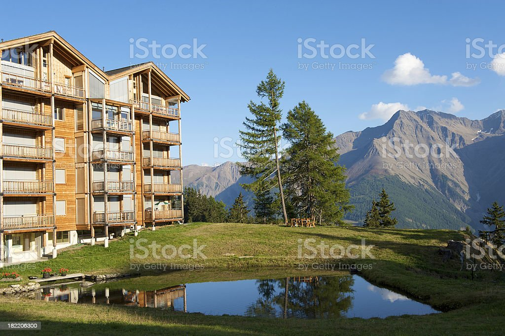 Apartment building in the Alps stock photo
