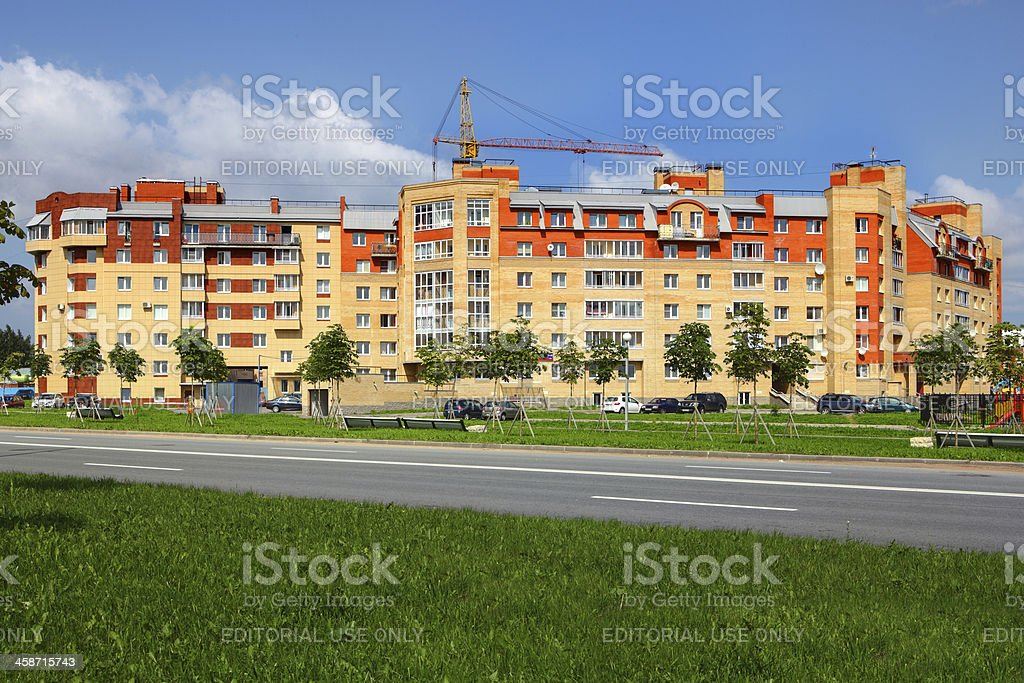 Apartment building, lined with ceramic tile and brick, six-story royalty-free stock photo