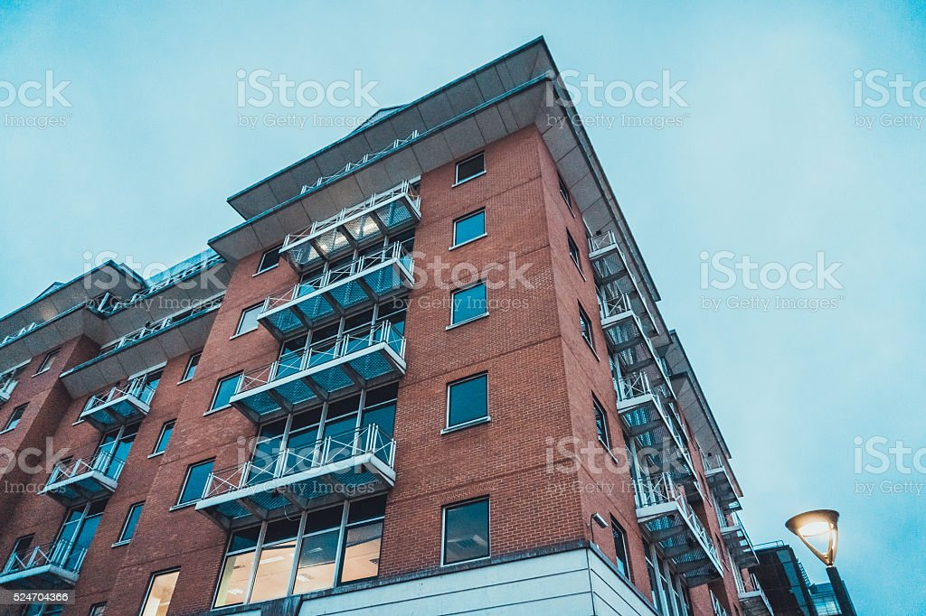 Apartment Building with Balconies in the Evening stock photo