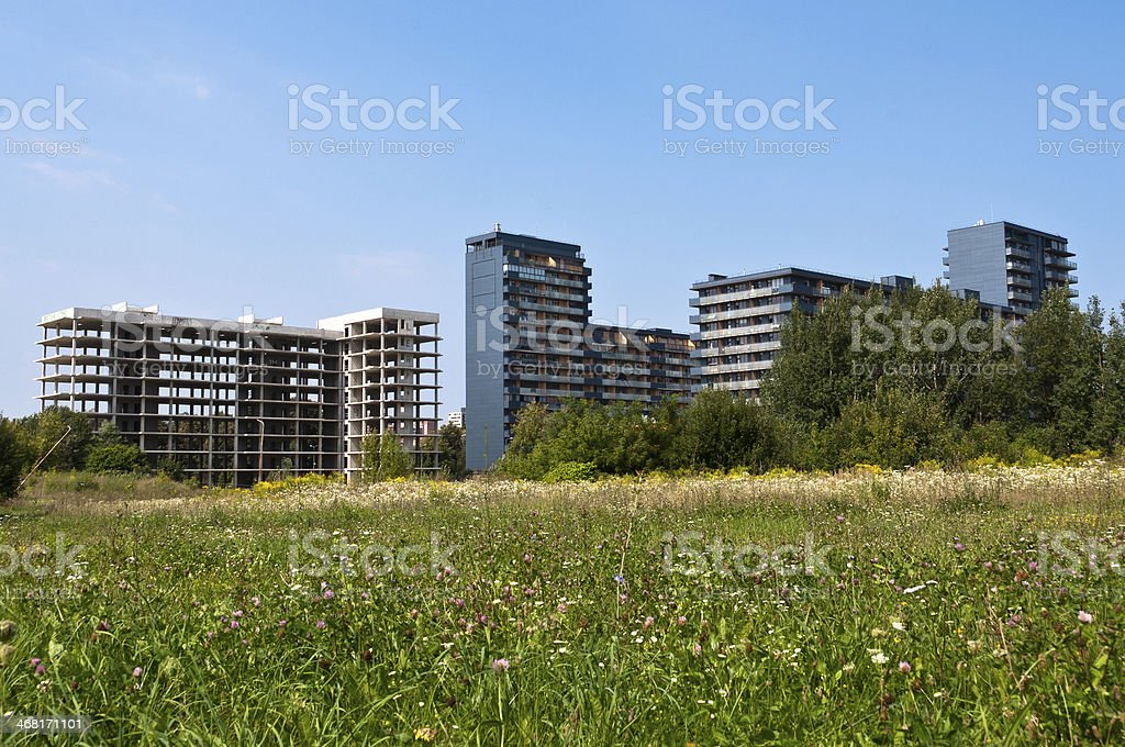 Apartment Buildings in Grass stock photo