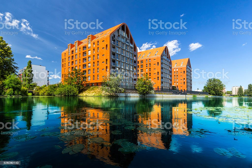 Apartment buildings on the river, Gdansk, Poland stock photo