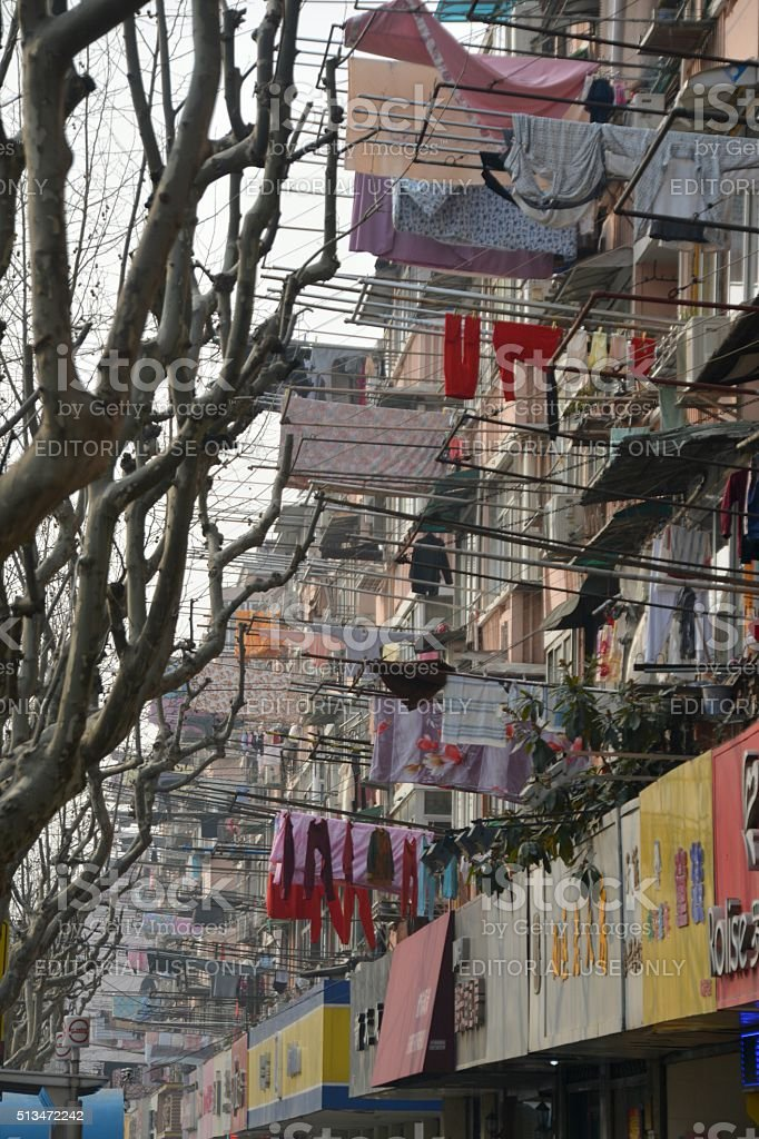 Apartment buildings with hanged dry clothes and sheets, Shanghai stock photo