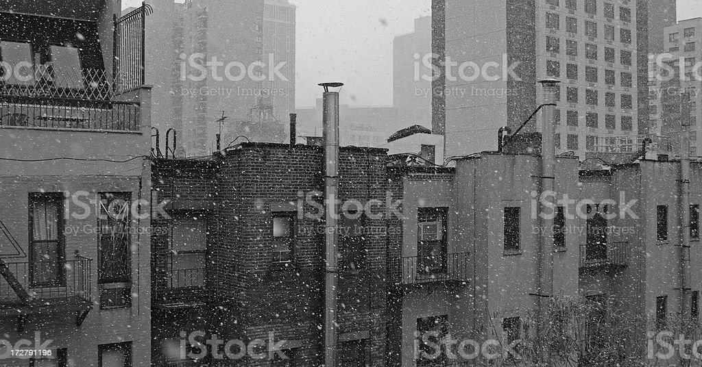 apartment buildings..and it's snowing stock photo