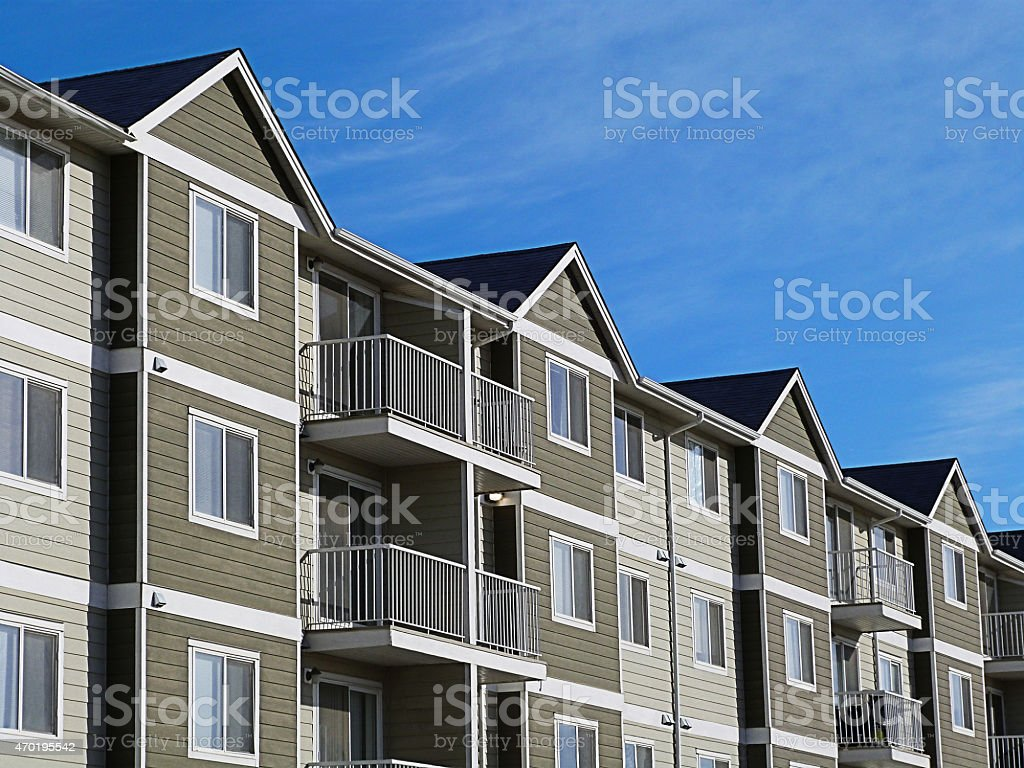 Apartment Complex With Blue Sky stock photo