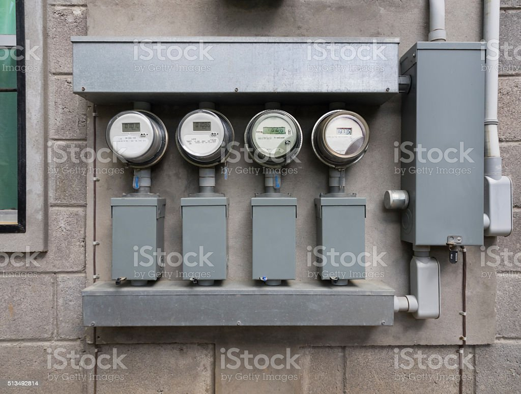 Apartment electricity meters stock photo