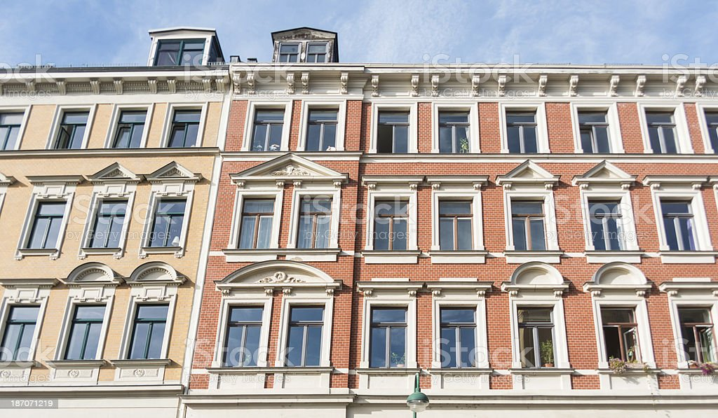 apartment home - red facade in leipzig germany stock photo