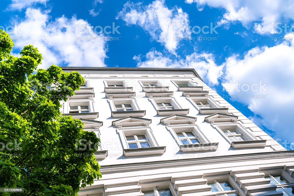 apartment house against blue cloudy sky stock photo