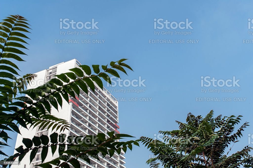 Apartment house behind trees in Berlin stock photo