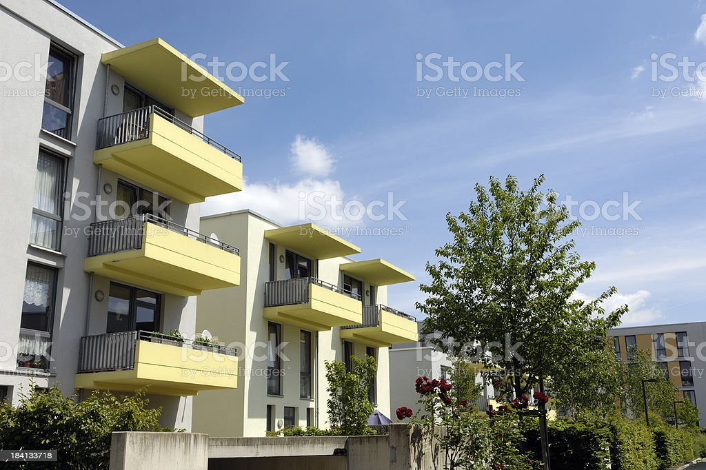 Apartment house with yellow balconies royalty-free stock photo