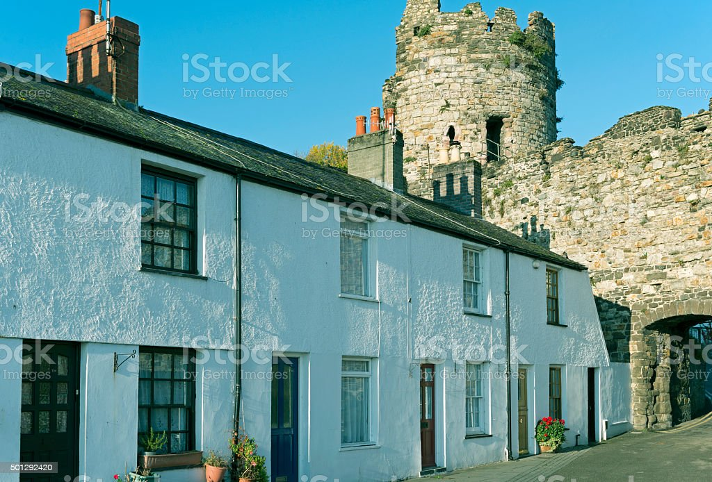 Apartment houses and medieval wall in Conwy Wales stock photo