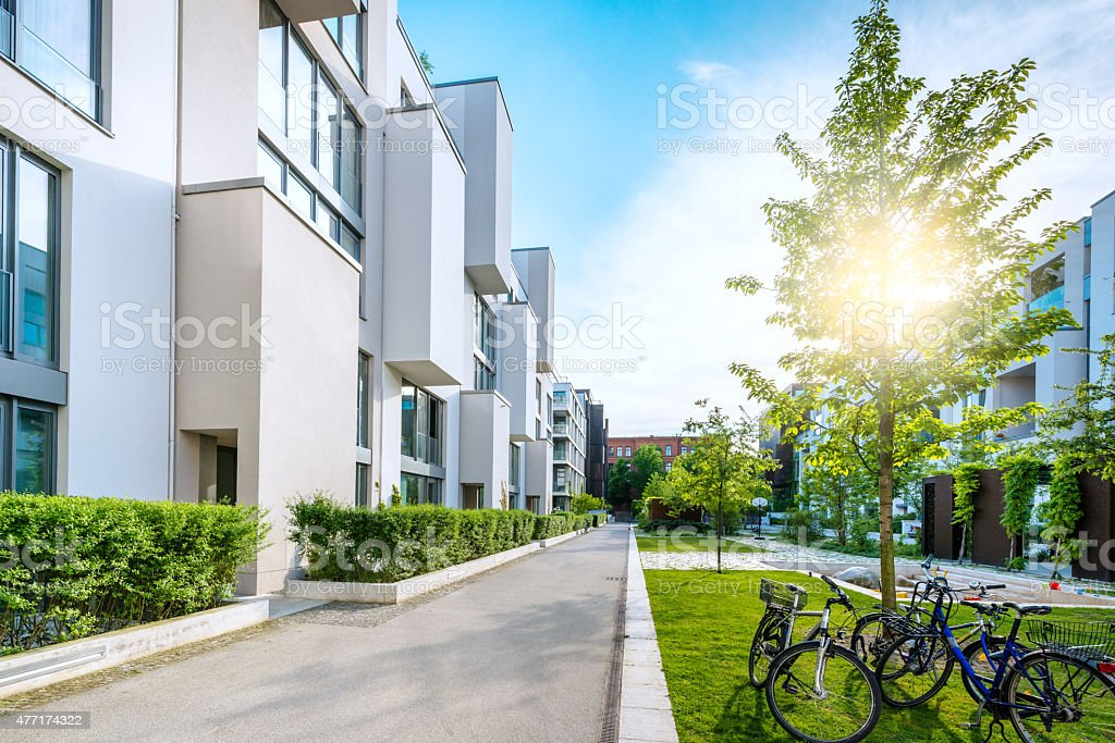 apartment houses in the evening sun stock photo