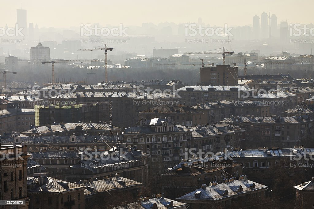 apartment houses lit by rising sun stock photo