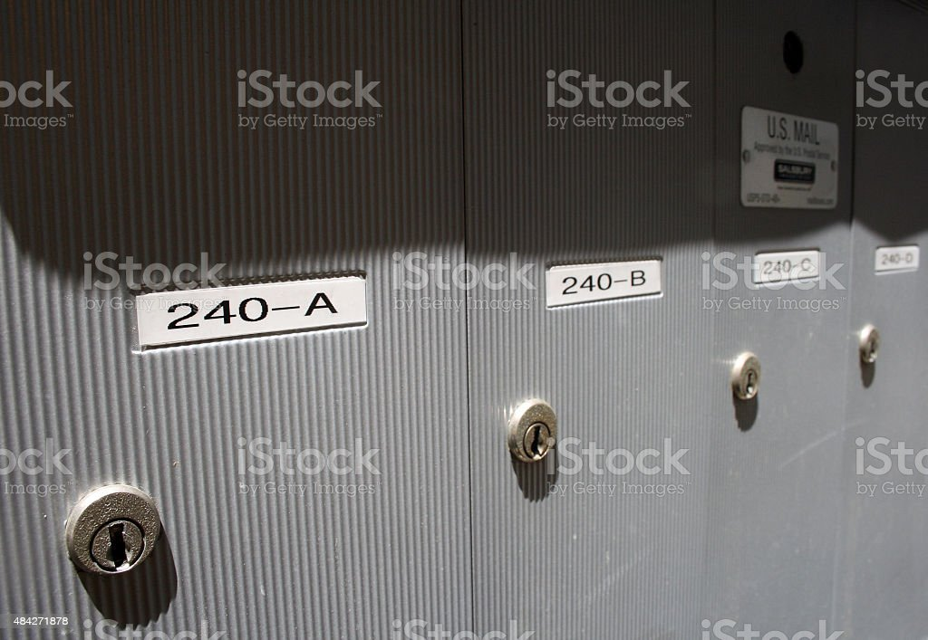 Apartment Mailboxes in Shadow stock photo