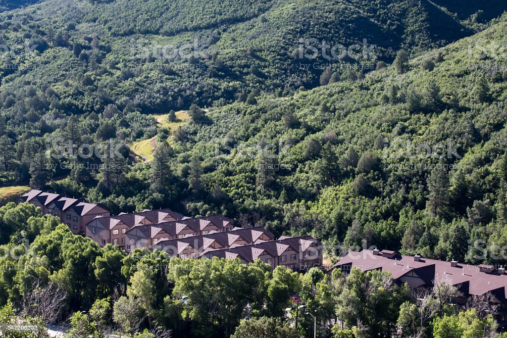 Apartment rooftops in a green forest in Colorado stock photo
