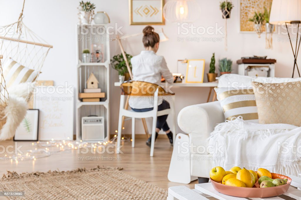 Apartment with working freelancer stock photo