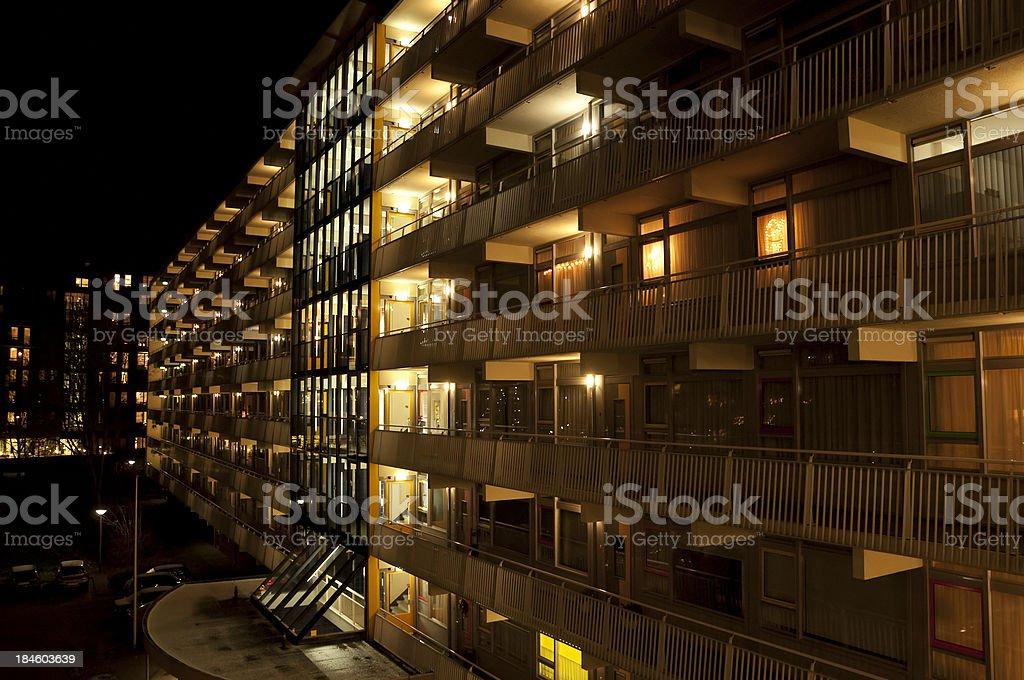 Apartments illuminated at night stock photo