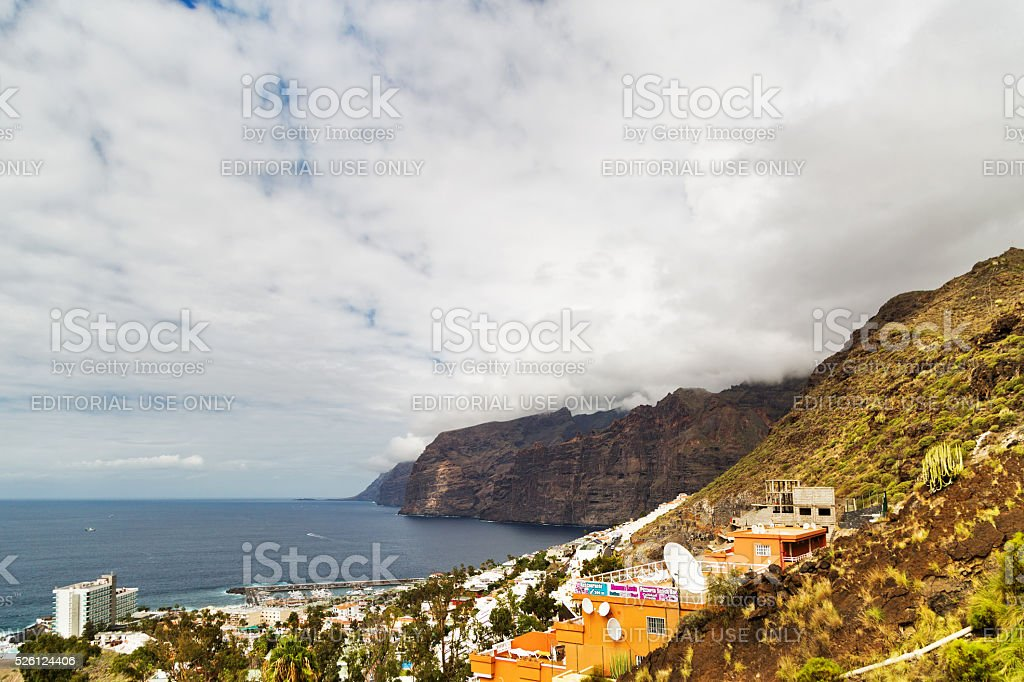 Apartments on slopes of the mountains stock photo