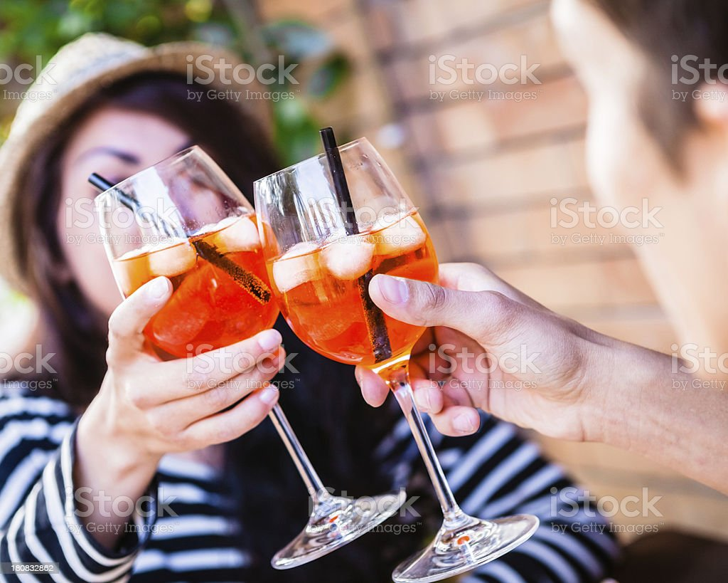 Aperitif Cocktail Toasting, Teenage Couple stock photo