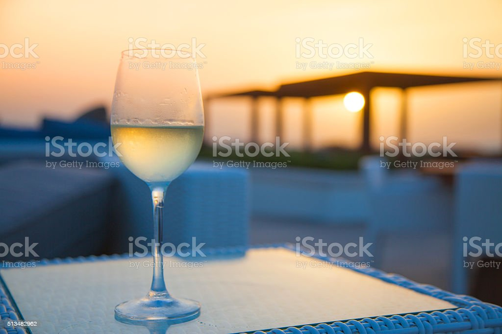Aperitif - Glass of white wine stock photo