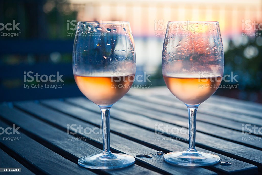 Aperitif - two glasses of rose wine stock photo